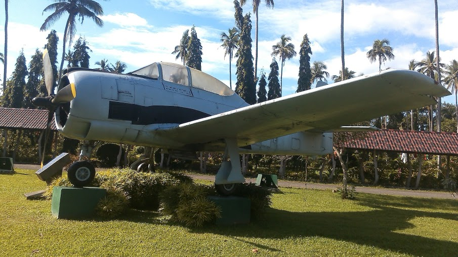 Photo is mine. Vintage fighter plane at Villa Escudero.